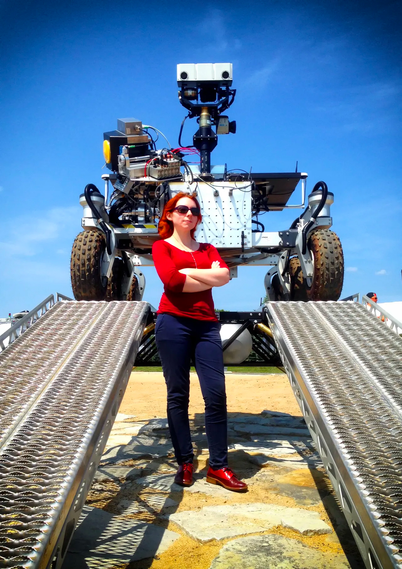 Dr. Tanya Harrison standing in front of the Canadian Space Agency's Mars Exploration Science Rover (MESR)