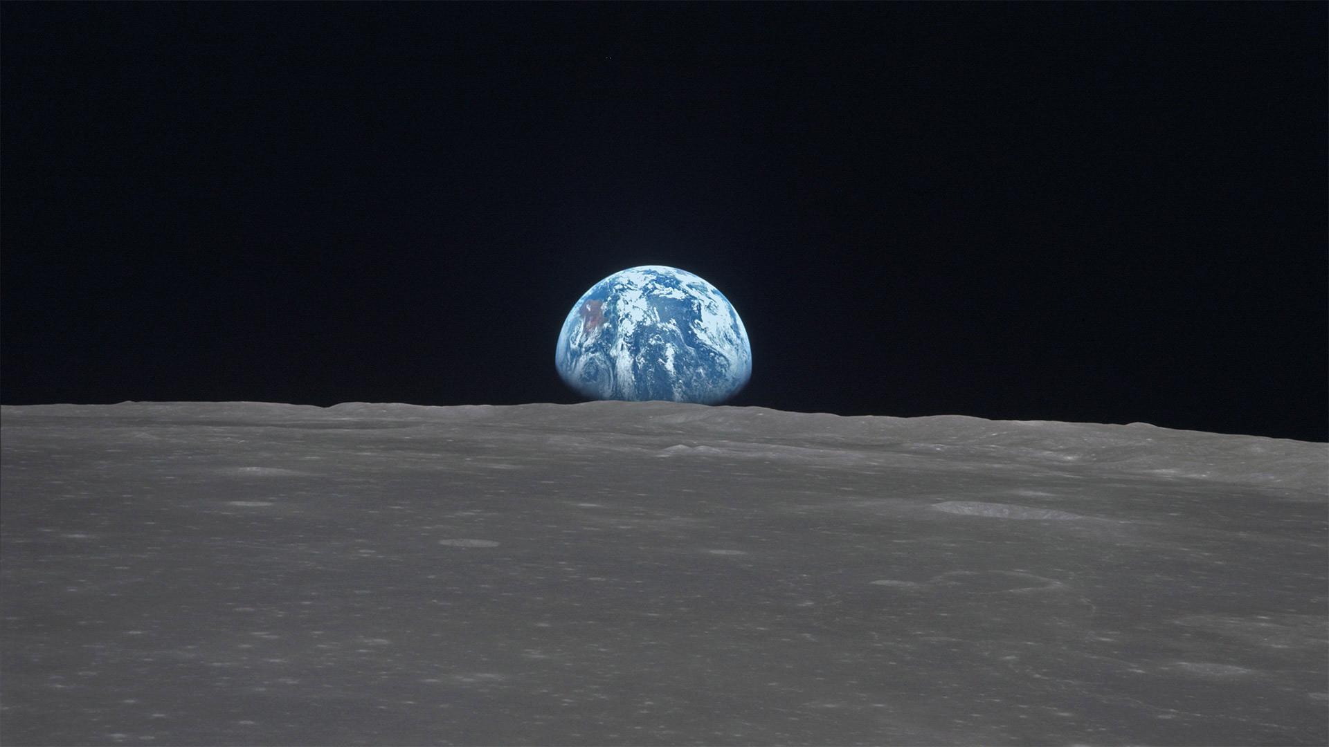 Kaguya spacecraft's view of Earth rising over the horizon of the Moon